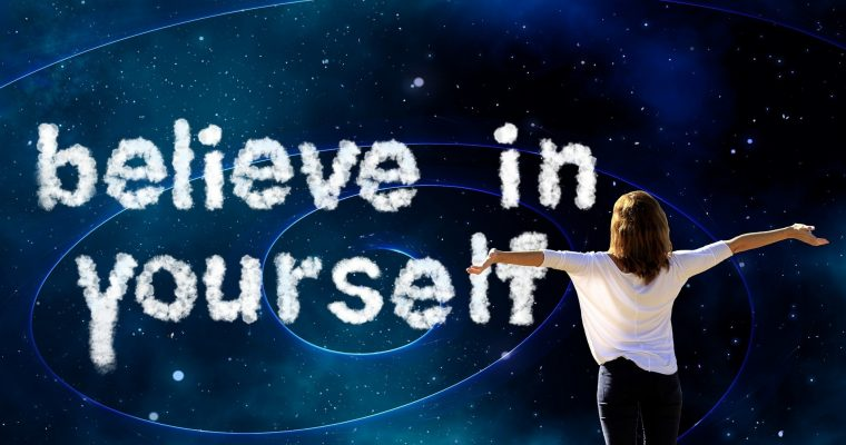Believe in Yourself Text on Blue Background - Woman Standing with Arms Outstretched
